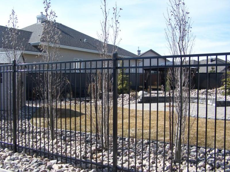 Rod Iron decroative residential fencing
