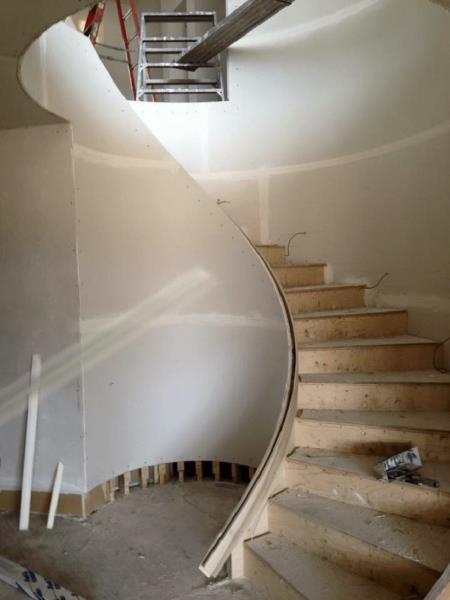 Curved staircase - Kelturn Drywall Regina.
