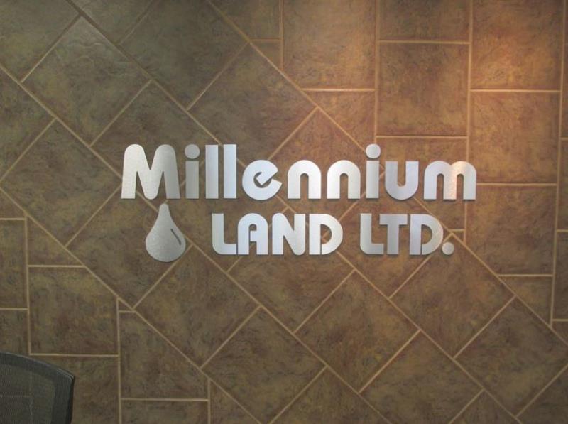 Millennium Land Metal Sign