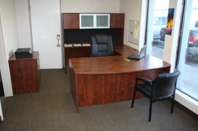 After: New Cognac Cherry office furniture installed by Greenway Furniture Installations