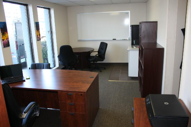 "Same office space with 2 office chairs, 42"" round table and 2 Mahogany bookcases"